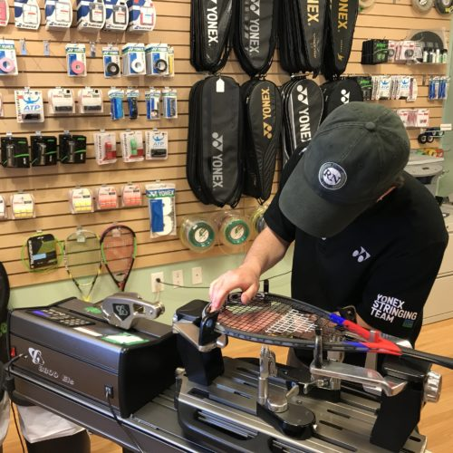 Stringing a squash racquet in our Calgary store.