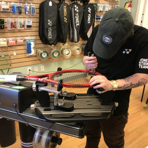 Coach Jarod stringing tennis racquets in our Calgary store.